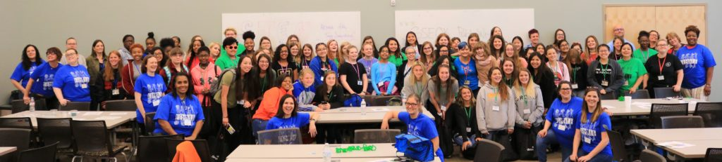"""A group photo from the Spring 2019 retreat. Many are wearing shirts that read, """"the future is female."""""""